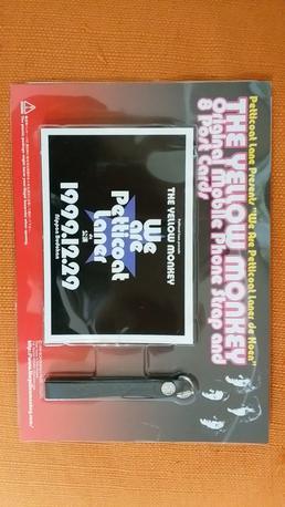 オリジナルストラップと八枚入りのフォトポストカード ライブグッズの画像