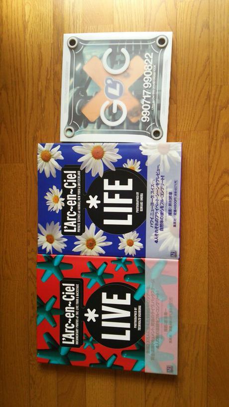 L'Arc~en~Cielの写真集とパンフレットです。 ライブグッズの画像